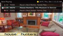 "TV screenshot of ""Now Playing"" guide."